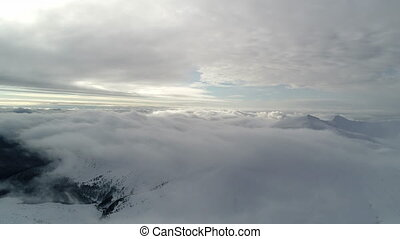 Aerial view in foggy winter mountain. Environment, nature...