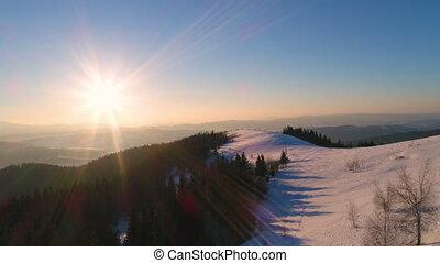 Aerial view in sundown winter mountain