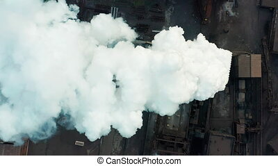 Aerial view. Industry Pipe Pollute the Atmosphere With...
