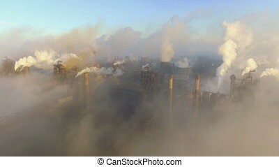 Aerial view. Industry Pipes Pollute the Atmosphere With...