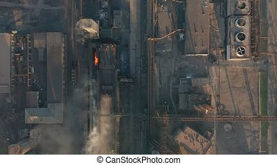 Aerial view. Industry Pipes Pollute the Atmosphere With Smoke