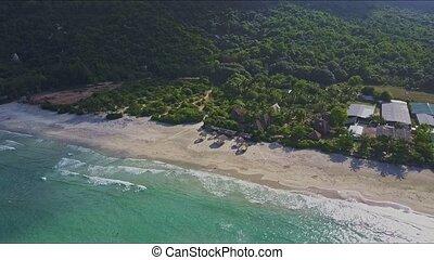 Aerial View Jungle Beach and Ocean Against Mountains
