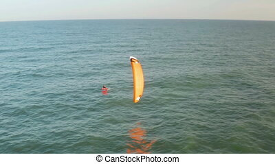 Aerial view kite surfing in sea
