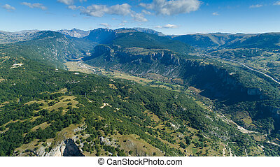 Aerial view Komarnica river canyon and the road to Zabljak