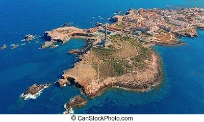 Aerial view. Lighthouse on island, Spain meditterian sea.