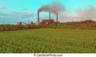 Aerial view. Metallurgical plant. Smoke coming out of ...