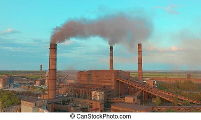 Aerial view. Metallurgical plant. Smoke coming out of factory pipes