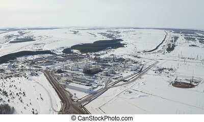 Aerial view modern facility with tubing or powerful process...