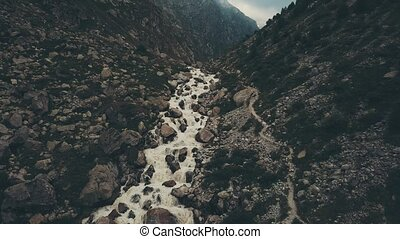 Aerial view mountain river and walking hiking group....