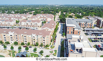 Aerial view multistory apartment complex and suburban residential area in Flower Mound, Texas, US