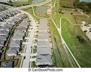 Aerial view new park side residential neighborhood with concrete