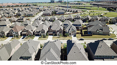 Aerial view new residential neighborhood near elevated expresswa
