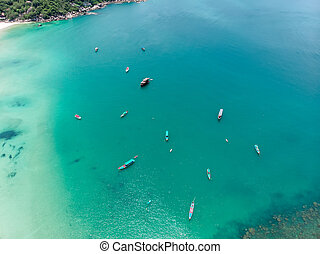 Aerial view of a Beautiful Bay with fishing boats in Thailand