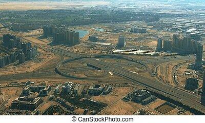 Aerial view of a big city highway interchange in Dubai, United Arab Emirates