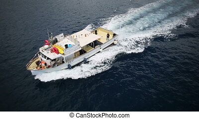 Aerial view of a boat navigating