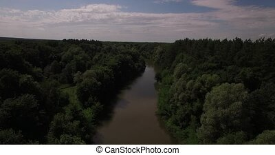 Aerial view of a bridge over a river, forest road and bushes