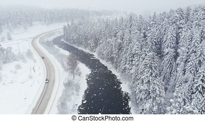 Aerial view of a country road in winter near a river and ...