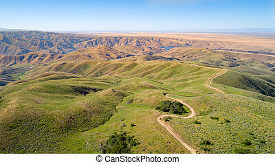 Aerial view of a dirt road leading in the canyon of the Boise River in Idaho