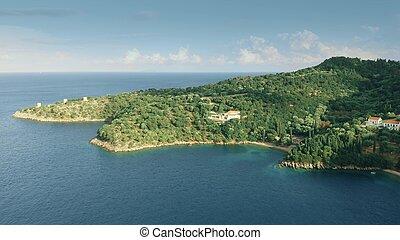 Aerial view of a distant coastal villa, Greece