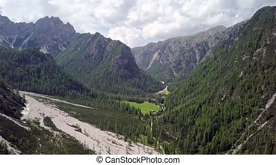 Aerial view of a field among the rocks in the alpine mountains