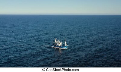 View from the height on a fishing boat sailing in the Atlantic Ocean