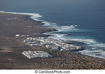 Aerial view of a fishing village on Canary Island Lanzarote Spain