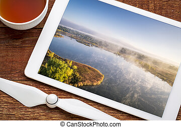 aerial view of a foggy lake in northern Colorado - aerial ...