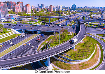 Aerial view of a freeway intersection. Road junctions in a big city