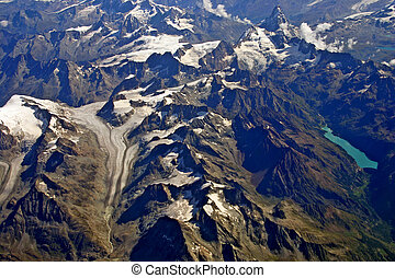 Aerial view of a glacier and lake in the Alps
