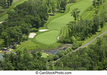 Aerial view of a golf course fairway and green