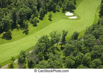 Aerial view of a golf course fairway with golfers
