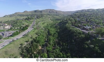 Aerial view of a green park between two foothills near Salt...