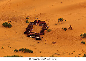 Aerial view of a group of Bedouin tents in Sahara Desert...
