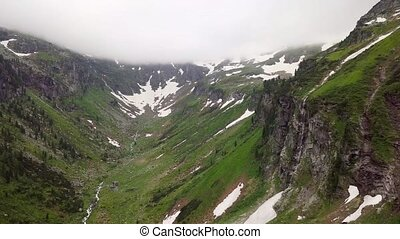 Aerial view of a high mountain canyon in the Alpine...
