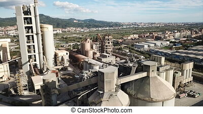 view of a huge cement plant with warehouses in Catalonia, ...