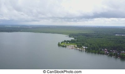 Aerial view of a lake and recreational area in nature. Amazing landscape. River water sunset landscape