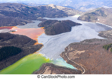 Aerial view of a lake filled with chemical residuals