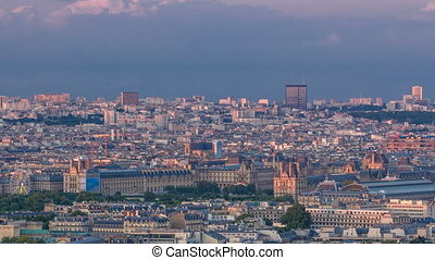 Aerial view of a large city skyline at sunset timelapse. Top view from the Eiffel tower. Paris, France.