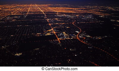 Aerial view of a large metropolitan city at night.