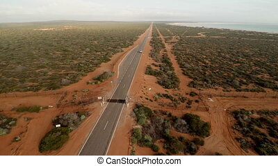 Aerial view of a long road in desert