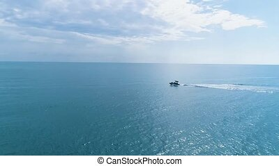 Aerial view of a luxury boat floating on the waves of the black sea