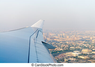 Aerial View of a Major City over the Airplane's Wing