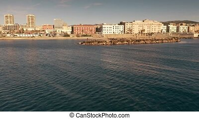 Aerial view of a man making photos on the pier and cityscape...