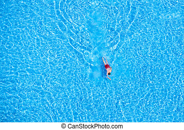 Aerial view of a man swimming in the pool