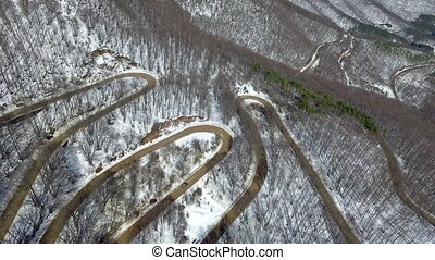 Aerial View of a Meandering Winter Road.