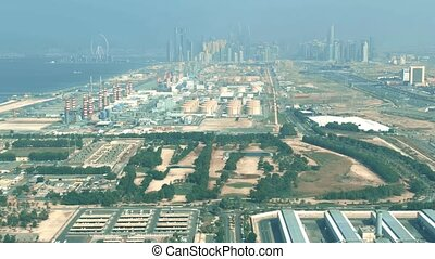 Aerial view of a modern power plant and water desalination complex in Dubai, UAE