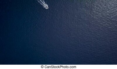 Aerial view of a motor boat sailing the sea fast - View from...