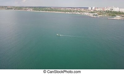 Aerial view of a motorboat floating in the sea - A...