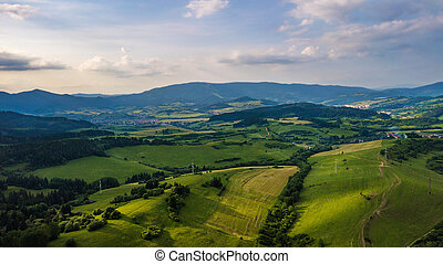 Aerial view of a mountain range with trees in the Tatra Mountains, Slovakia