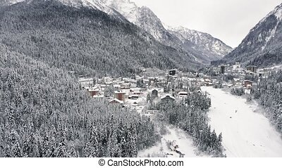 Aerial view of a mountain village. Winter landscape